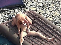 amateur couple enjoying sex at the beach (secretly filmed).
