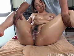Gorgeous Japanese bimbo in sexy panties stimulated as her body is oiled then massaged before getting drilled with toys till attaining an orgasm