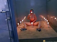 Angel sitting with a burning candle in his face hole