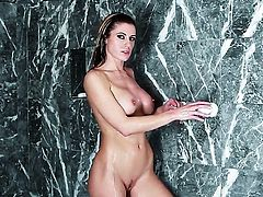 Randy Moore with huge melons and shaved cunt gets naked and plays with her muff