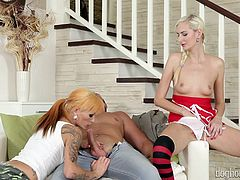A slutty babe with white dyed hair wearing stockings surprises a horny couple engaged in lusty activities while coming down the stairs. The naughty babe stops and begins rubbing her pussy and also she shamelessly exposes her small tits. See Adel getting on knees near the blonde tattooed milf to suck cock!