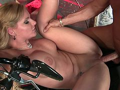 blonde with fake tits and in leather outfit get convinced by her lover then gives hot blowjob and drilled doggystyle in close up scene
