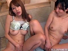 Hot Japanese porn star with fantastic natural tits taking soapy dip in bath before giving erotic blowjob in steamy threesome