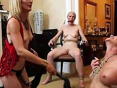 These blondes really know how to have a good time! They've tied one of them and pinned another one on the floor. The sluts are really naughty and up to no good so they've made the tied one to look how they punish and finger the other blonde girl, probably her lesbian gf. What do you think, are they gonna get worse?