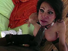 The sexy and experienced Teri has just come home to her mansion with her black lover. they are dressed fancy, but they want to get naked. She takes off her dress and lays back into his lap. She gets her pussy rubbed and sucks on his huge black penis.