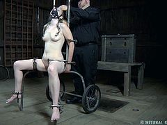 Chained and restrained chick gets her pussy squeezed