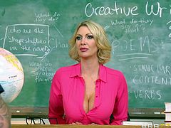 The atmosphere in the classroom is extremely intense. The blonde-haired imposing teacher seems to soften, when alone with a hot stud to whom she shows her incredible big tits. Watch them kissing with passion. The best part begins with the hot milf unzipping the student's pants. See what happens next!