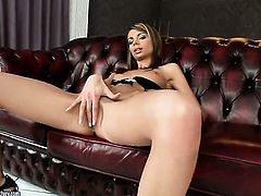 Brunette Betty Stylle plays with dildo