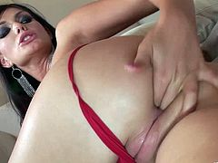 Stunning brunette pornstar with piercing in a sexy thong and high heels fondles her big tits as her shaved pussy gets licked before being fucked