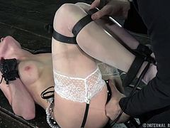 Lustful brunette in white stockings moans with pain in BDSM sex clip