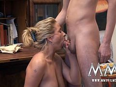 Bosomy blond cougar pleases young stud with steamy deep throat