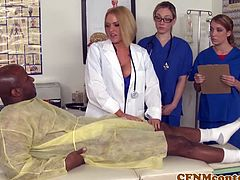 Dr. Krissy Lynn and her nurses were taking care of a patient when Dr. Voodoo came in to over see everything. He did a poor job of taking care of the patient before he quickly left again and that upset everybody. Dr. Krissy decided to relive some stress by giving the patient some extra tests on his cock and balls. Dr. Krissy began by rubbing his balls and then stroking his cock. The nurses took turns sucking that cock while Dr. Krissy supervised the operation. Dr. Voodoo came by to check up on the patient and caught this whole scene going down. He began to yell at everyone and Dr. Krissy had en