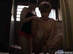 This is a hot horny Japanese bang and blowjob scene with a mature hottie serving a handjob to a young stud's huge cock hardcore.