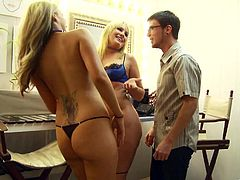 Two cute blondes wearing thongs give a great blowjob to a guy