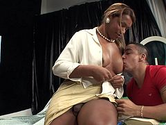 She unbuttons her blouse and he sucks on her big boobs. The gigantic tranny has her way with her small man, and she makes him suck on her big cock. He deepthroats her and she guides his cock down onto the base of her shaft.
