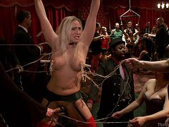 The blonde with big tits is tied up and the men at the party dominate her. She has nipple clamps that are pulled on by the group. She gets fingered, too. Another slave gets pounded hard by big cock as her boobs are grabbed.