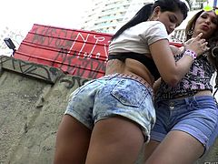 This lady and tranny pull down their jean shorts and flash their bums in the alley. They head inside for some fun. Watch as they suck nipples and gaze in wonder as the tranny has her cock tugged on. They love getting nasty.