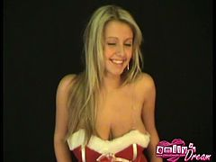 Emilys strips her holidays costume to tease us in this horny solo. This busty blodne whore is ready to make you fantasies come true as she satisfies her own on camera.