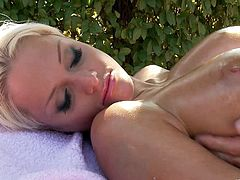 Blazing blonde cougar MILF thrilled as she gets oiled then moans as her big tits are fondled before her entire body is caressed then gets fingered