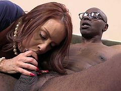 Busty red haired hooker with fat ass Janet Mason satisfies 2 black guys