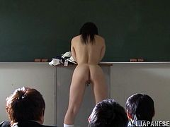 She gets in front of the class to read her poem, but the boys are horny and want to see her naked. They make Ai strip and lean over the desk, to show off her cunt and butt from behind. She actually loves to strip and be watched by the class.