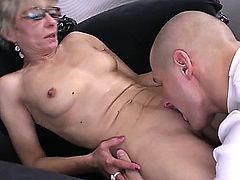 attractive skinny 50+ milf with glasses gets fucked by her young admirer.