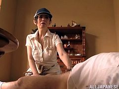 He lays back in the middle of the living room with his pants down and this mature Japanese lady is going to have some fun with him. She jacks him off, until he is rock hard. Watch, as she gives him a blowjob, too.