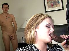 This unlucky white loser has to sit in the corner and strokes his tiny white cock, while his wife deep throats a massive white dong, that is so big, she almost chokes on it. The big black cock even gets shoved in her big white tits and the husband has no choice, but to watch, and wish he could fuck her.