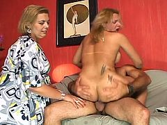 This busty shemale gets cock in her mouth and fucks this stud in the ass before he gets fucked in the ass as well, while a mature gal watches and joins in some times in this free video.