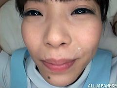 Gorgeous Japanese in a nurse's uniform thrilled as she gives a stunning blowjob before giving a sensual handjob till she gets a facial cumshot