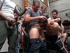 This is a very humiliating scenario for this gay slave. He is bound tightly with rope and hanged in a position, that gives everyone easy access to his asshole and mouth. He has to choke on multiple cocks and take huge rods in his tight little butthole.