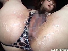 Watch as this dirty whore opens up her legs, to have a fake cock shoved inside of her wet pussy. The plastic cock is thrust in deep. Her man jacks off and cums inside, and all over her hairy twat. What a mess he has made. She is finished off with a vibrator.