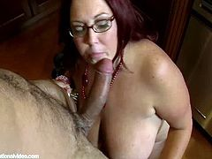 Peaches Larue plays with her belly before she grabs this guy's thick cock and gobbles on it for a while. Next, she takes it in her chubby pussy and drips of excitement.