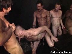 Jayson is the bottom bitch who gets fucked by four daddies, including Ray and Mitch. Ray helps him out by sucking cock when all Jayson's holes are already filled.