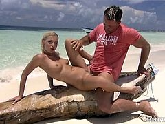 The summer heat is making this blonde babe super horny. Out on the beach she has her legs wide open as she gets her pussy finger fucked by a handsome guy. Claudia Adams steams up the summer by fucking her beach buddy out in the open.