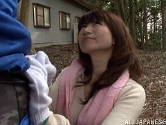 While outdoors for a hike this Japanese girl gives her man a blowjob