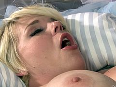 This sexy blonde slut is lying on her back, and that's the position she likes to be in best. Her pussy hole gets rammed by a big black cock, and then she sucks it and licks her pussy juice off of that big black member. He oils up her tits and fucks her between them.