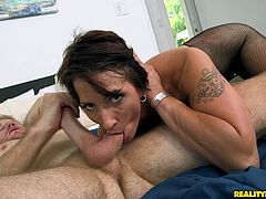 Sensuous brunette in sexy fishnet stocking gets her shaved pussy fingered then hammered hardcore