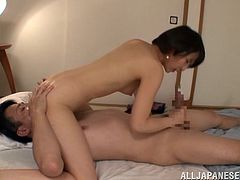This sexy short haired Japanese lady is horny and ready to fuck. She opens her legs for cunnilingus, and then she slobbers all over his cock and balls. She rides his stiff rod while he licks and rubs her tits.