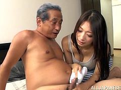This sexy Japanese brunette takes out a nice warm towel and wraps it around her old husband's cock. She washes his penis to get it nice and clean. The Japanese lady washes his shaft and tip before wrapping her lips on his cock and giving him a nice blowjob. Will she let him cum on her?
