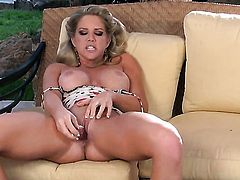 Ainsley Addison with big boobs and shaved beaver shows it all in a tempting manner
