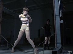 Slim brunette with hard and perky nipples gets punished