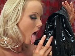 Silvia is a great fan of latex, she loves wearing different pieces of clothing, made from latex. As one can notice, the slutty blonde milf with lovely tits is dressed up with black pants and high heeled boots. The bitch gets really excited, as she begins to lick her shoes. You can read lust in her eyes. See!