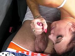 Sexy porn star with long dark hair sucking a stranger's big cock in his car