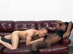 This elegant black transsexual sits on her Asian boyfriend's face and makes him suck on her ebony cock. She lays back and he gives her a great blowjob. She loves it and moans loudly, as he sucks her cock off. She looks so dominating in her tall boots.