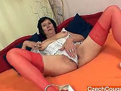 Nasty grandma named Lilie was so alone for a week and whenever she gets bored and not doing any stuff she wears a sexy dress and started masturbating using her dildo.
