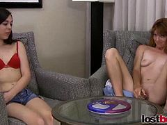 Horny amateur girls Erin and Betty Jo playing a bet game and who lose will start to get naked in front of them and start playing their hot cunt with a sex toy.