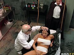 This mad scientist doctor has done some operations and made a lovely, beautiful woman, with the help of his medical helper. The lady on the operating table is a blowjob fiend and as soon, as she is brought to life, she starts to suck the doctor, and kiss the helper.