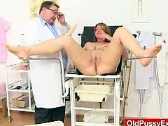 This busty mom with blonde hair and generous curves pays a visit to her gynecologist. He is in a naughty mood so, he spreads her cunt with a speculum and a vibrator.