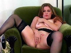 Amazing solo model in nylon stocking stripteases seductively while displaying her hot ass before fingering her shaved pussy